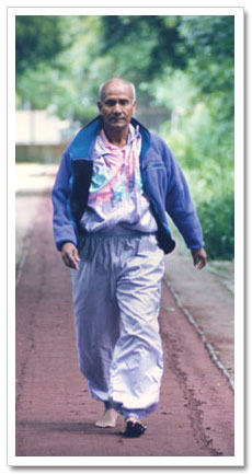 Sri Chinmoy walking